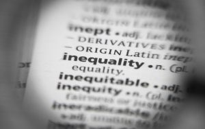 Image of the word 'inequality' highlighted in a dictionary page (credit: sharafmaksumov / Adobe Stock)