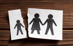 Outline image of family with child at a distance from parents (credit: adragan / Adobe Stock)