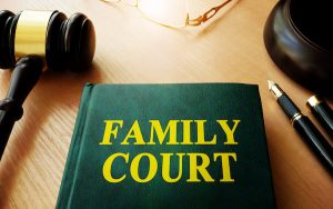 Image of book marked 'family court' and judge's gavel (credit: Vitalii Vodolazskyi / Adobe Stock)