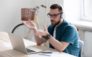 Image of man with laptop making video call (credit: fizkes / Adobe Stock)