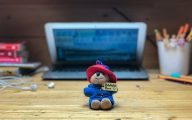 Toy in front of laptop
