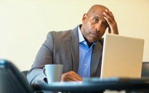 A Black social worker looking downcast