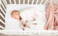 Image of sleeping baby in cot (credit: Pixel-Shot / Adobe Stock)