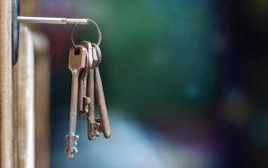 Image of door with keys in (credit: Luka / Adobe Stock)