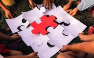 Children piece together a jigsaw