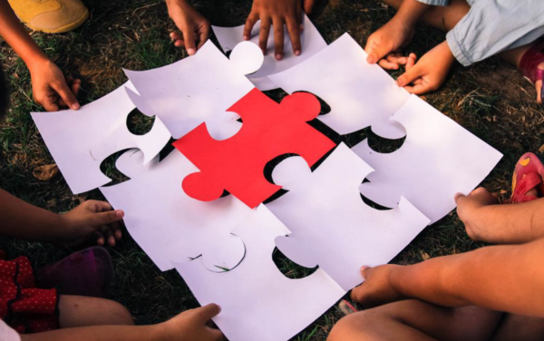 Children piece together a jigsaw