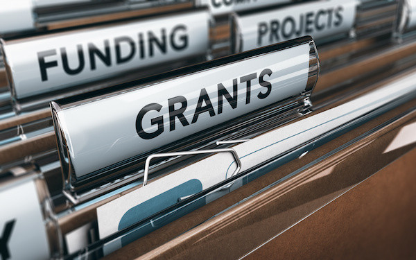 Image of files marked 'funding, projects, grants' (credit: Olivier Le Moal / Adobe Stock)
