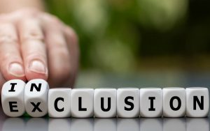Symbol for a better inclusion. Hand turns dice and changes the word exclusion to inclusion.