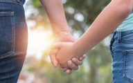 Image of female child holding female adults' hand (credit: Chinnapong / Adobe Stock)