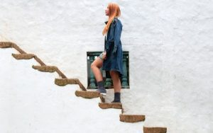Woman walking upstairs