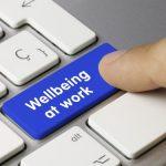 'Wellbeing at work' key being pressed on keyboard