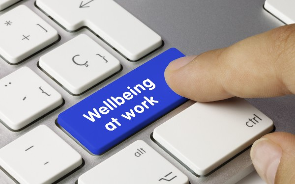 'Wellbeing at work' key being pressed on keyboard