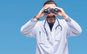 A doctor looking through binoculars