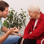 Social worker talking to older woman