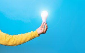 Woman holding lightbulb